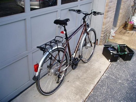 Homemade Hardside Panniers next to the bicycle