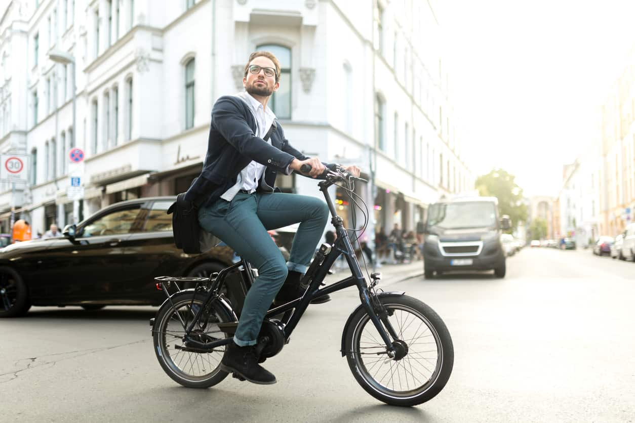 a man riding an electric bike
