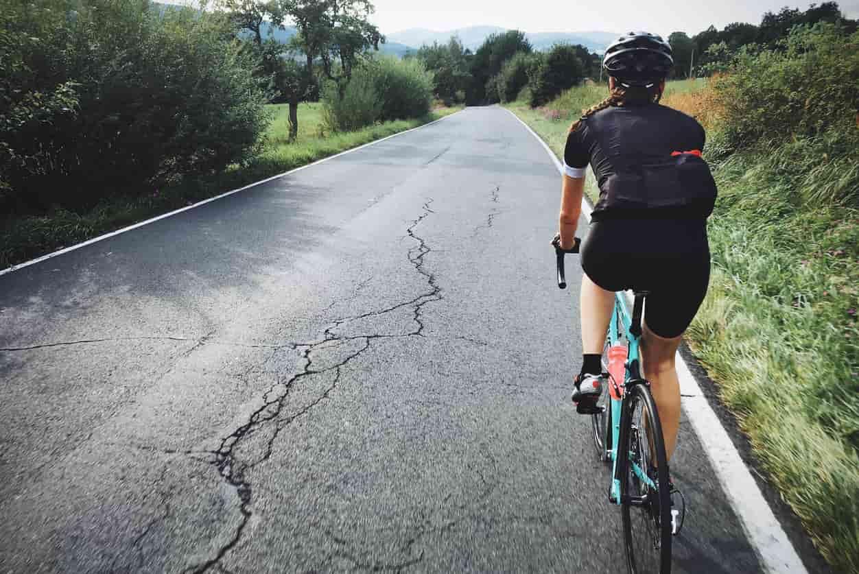 a woman riding a bike back view