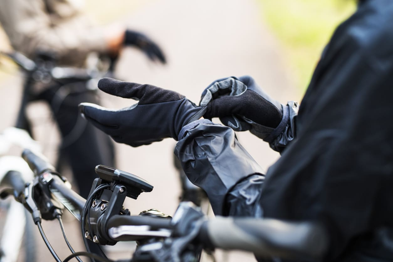 putting on bike gloves