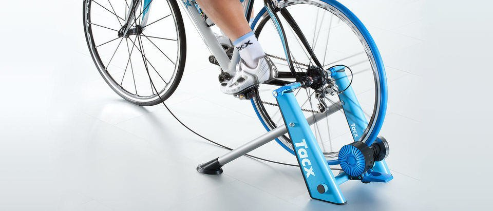 Bicycle Mounted on a Blue Bike Trainer