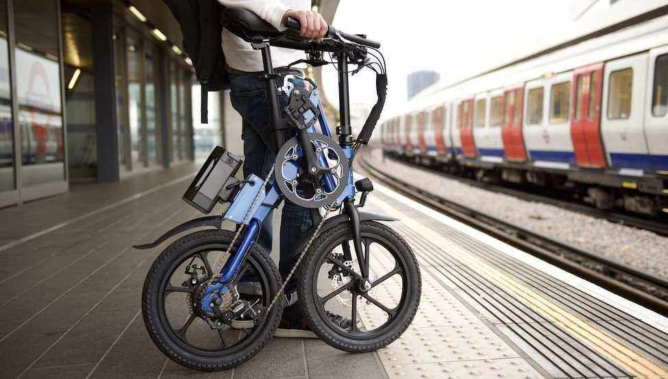 Commuter Carrying a Folding Bike