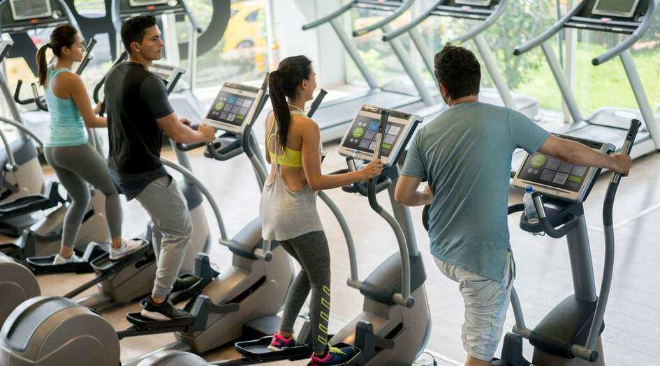 Gym-Goers Using the Elliptical Trainer