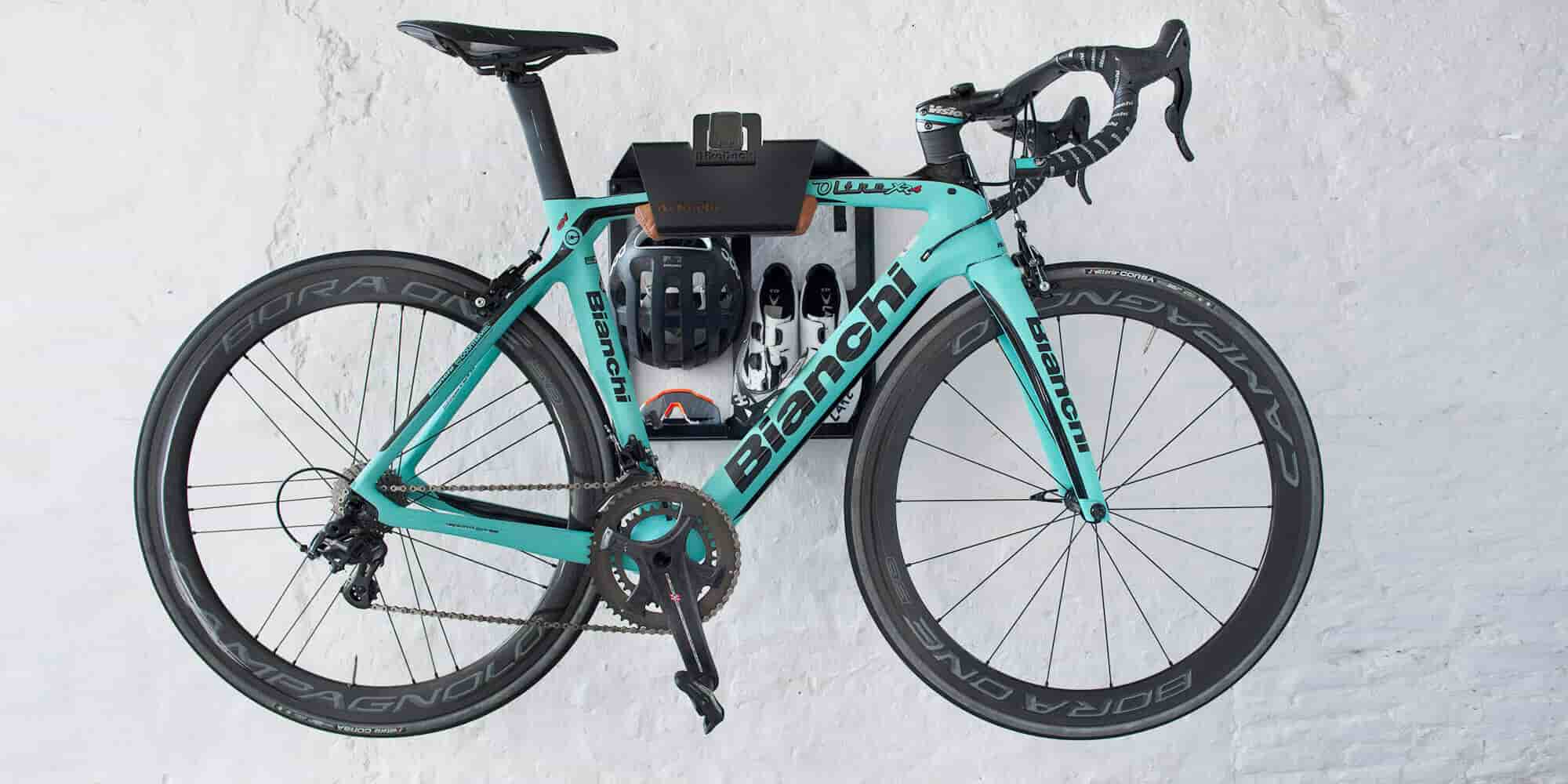 bianchi road bike mounted on the wall