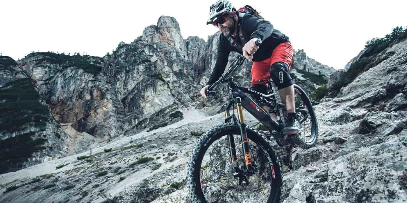 cyclist riding his electric mtb downhill
