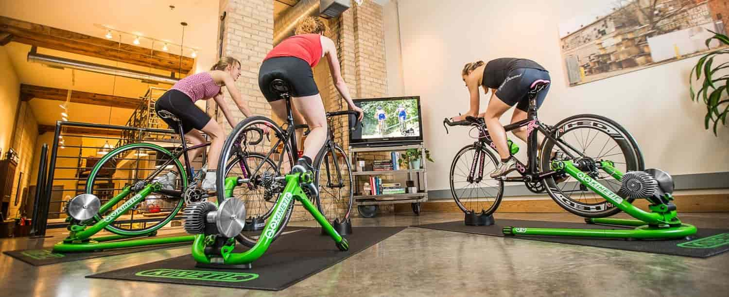 three cyclists using kurt kinetic trainers