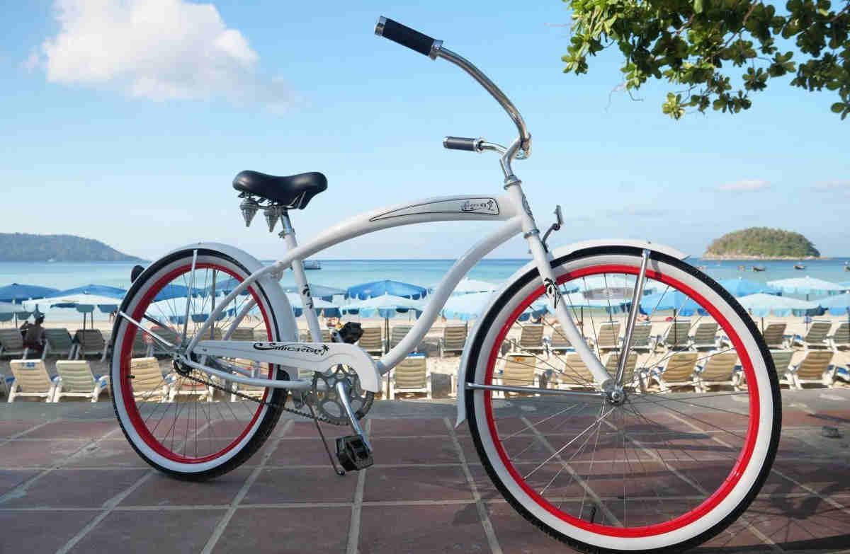 white cruiser bike near the beach