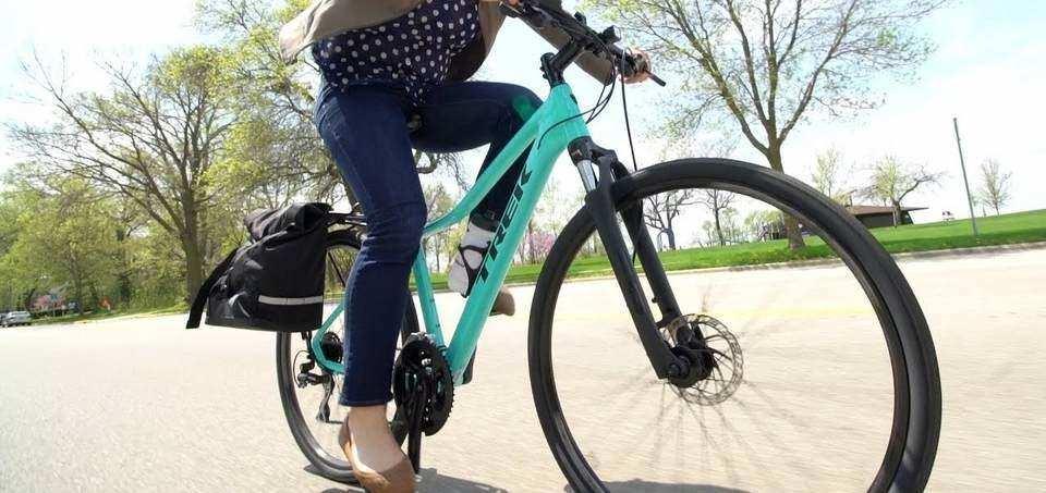 woman riding a Trek hybrid bike