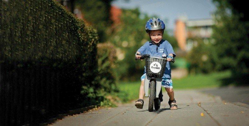Child Riding a Balance Bike