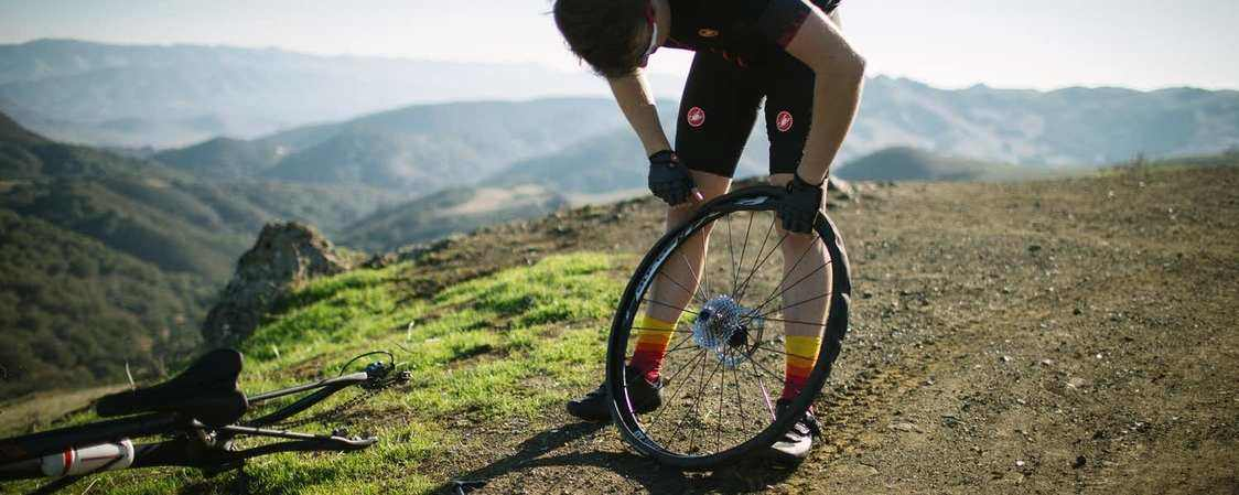 Mountain Biker Fixing a Flat Tire