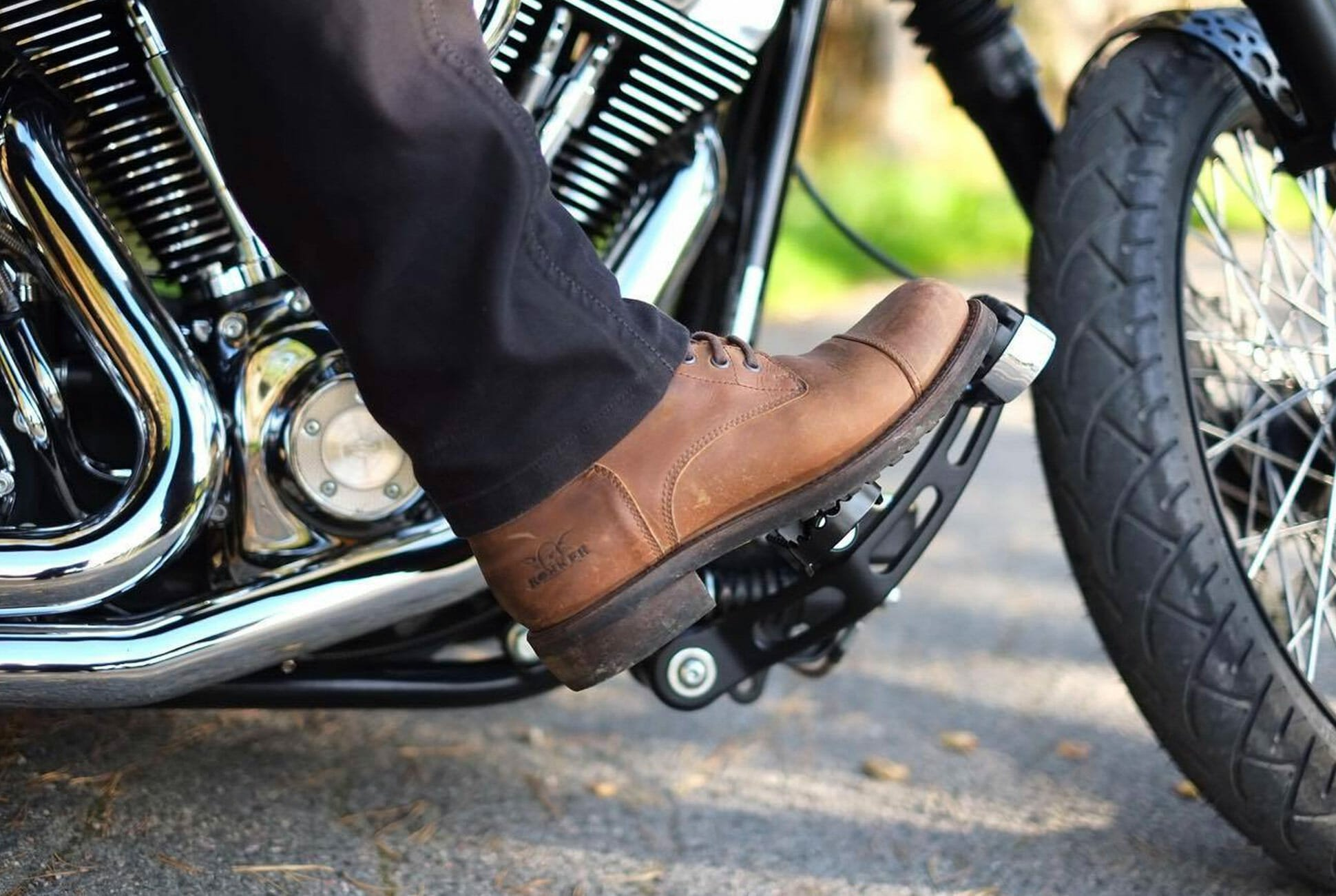 a brown boot on a motorcycle clutch