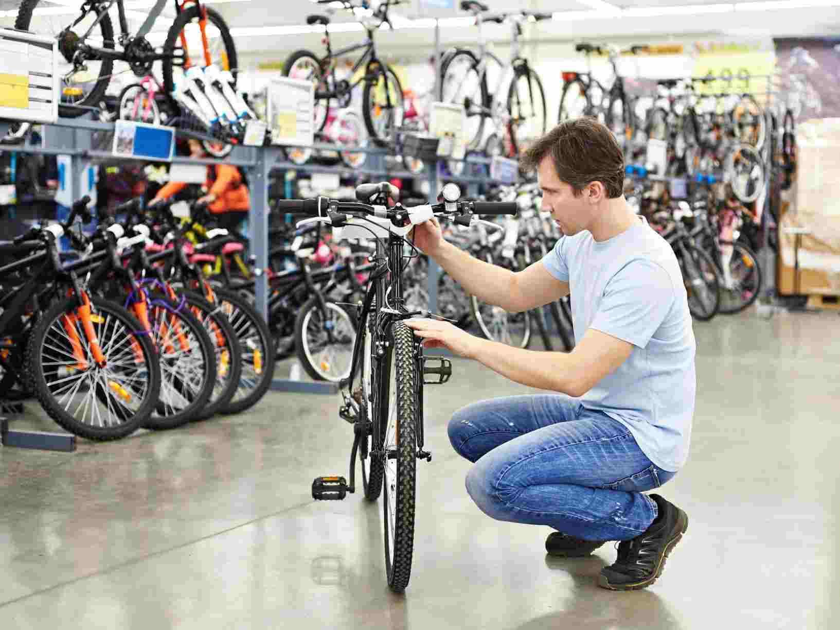 a man checking out a bike