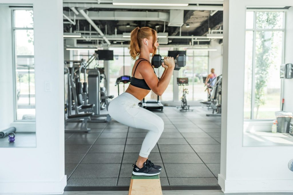 girl carrying dumbbell