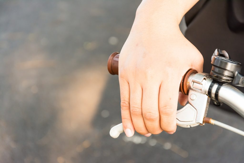 hand with brake of the bike