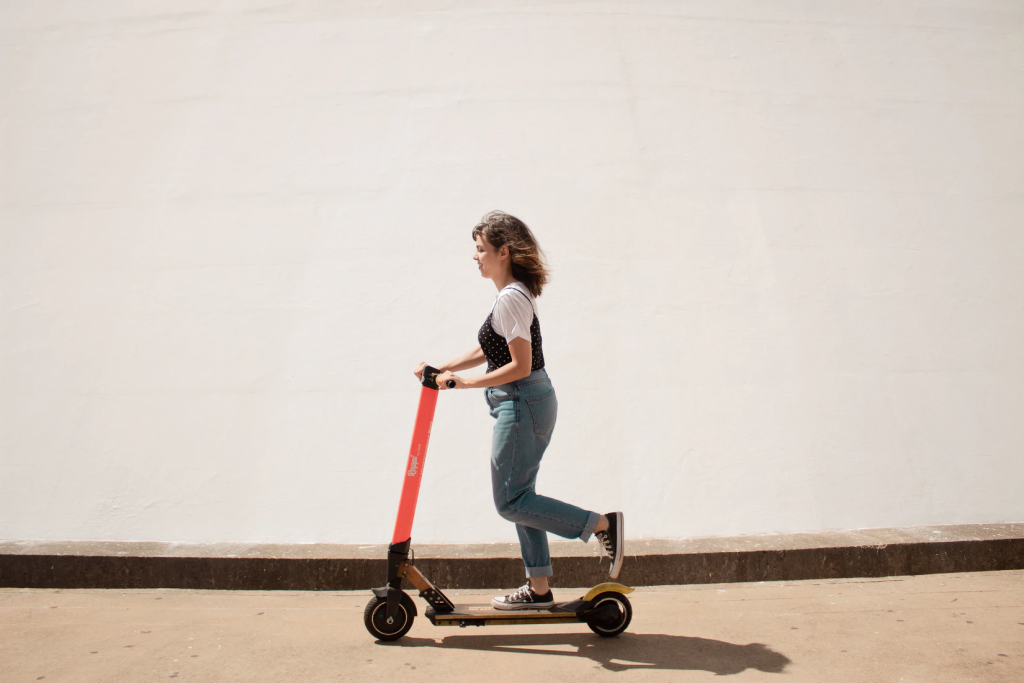 a girl on a scooter