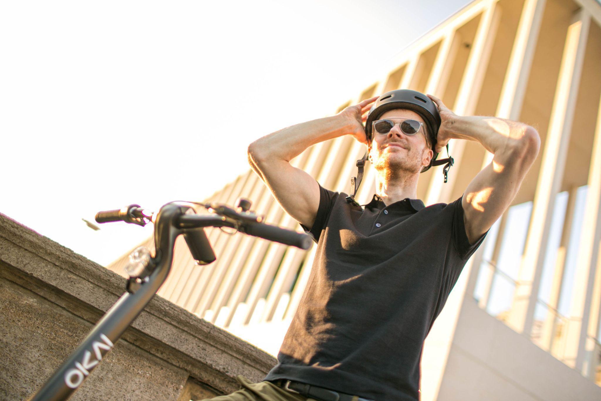a man riding a scooter
